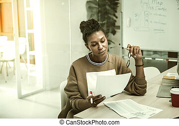 African-American office worker feeling busy preparing her speech