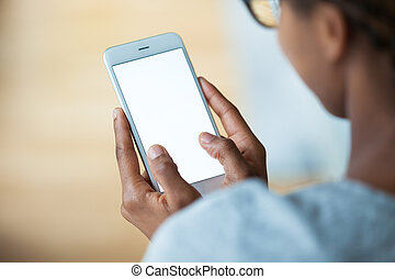 African american person holding a tactile mobile smartphone...