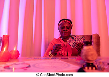 African american plump fortune-teller in ethnic adornments ...