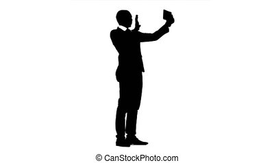 African american speaks by video call on the phone White background. Silhouette