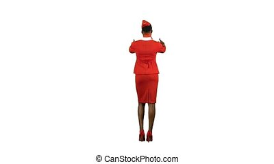 African American girl in red suit, she stewardess shows gestures with a spare exit . Alpha channel. Back view