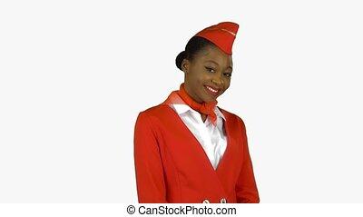African American stewardess winks a slight flirt sends an...