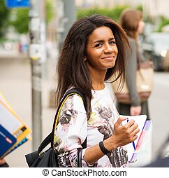 African-american student girl in a city