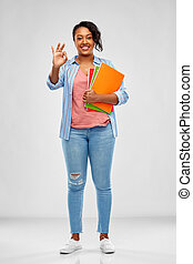 african american student woman with notebooks