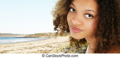 Attractive 18 year old African American teenage girl at beach.