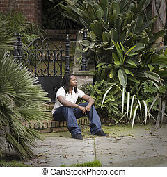 Teen Boy Sitting on Step