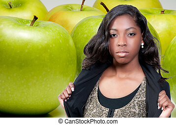 African American Teenager and Granny Smith Apple