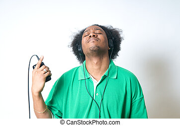 African American Teenager listen to music