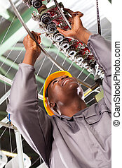 african american textile technician repairing - african...
