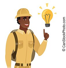 African-american traveler pointing at light bulb.