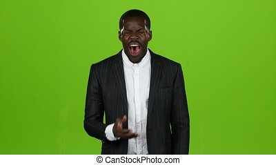 African american, very tired at work and wants to sleep, he yawns. Green screen
