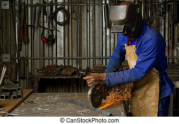 African American with angle grinder - South or African...