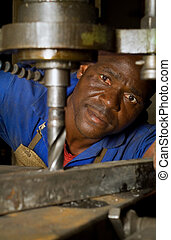 African American with drill press