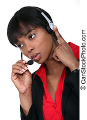 African American woman answering the hotline.