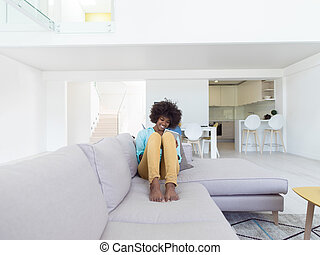 african american woman at home using digital tablet