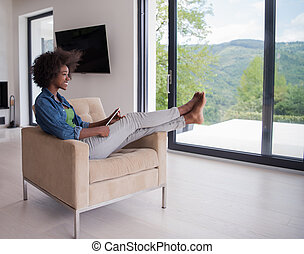 african american woman at home with digital tablet