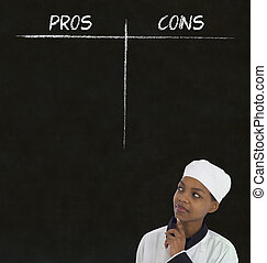 african american woman chef thinking with chalk pros and cons on blackboard background