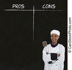 african american woman chef with chalk pros and cons on blackboard background