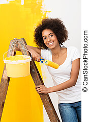 African American woman doing home renovations