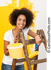 African American woman doing redecorating
