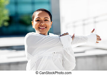 african american woman doing sports outdoors