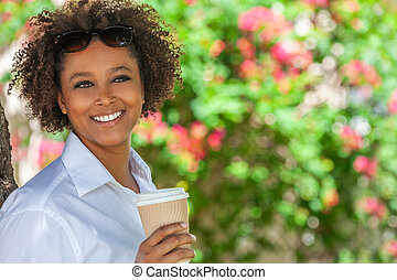 African American Woman Drinking Coffee Outside