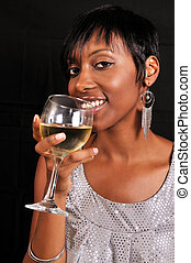 African American woman enjoying wine