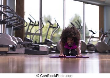 african american woman exercise yoga in gym