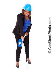 African American woman holding a demolition hammer, isolated on white background  - Black people