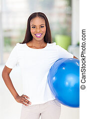 african american woman holding fitness ball