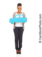 african american woman holding paper car