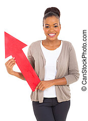 african american woman holding red arrow