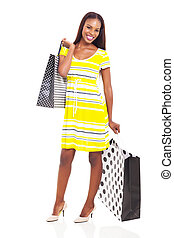 african american woman holding shopping bags