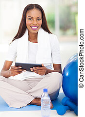 african american woman holding tablet computer
