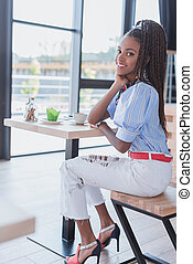 african american woman in cafe