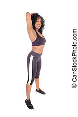 African American woman in exercising outfit.