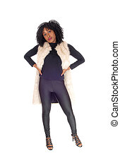 African American woman in fur coat.