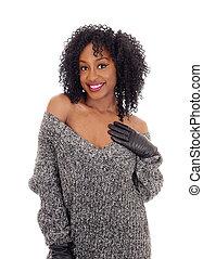African American woman in gray sweater.
