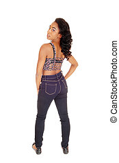 African American woman in jeans from the back.