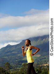 African american woman jogging outdoors in nature