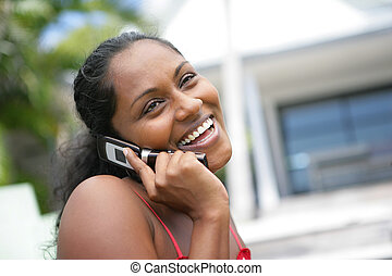 African American woman laughing during call