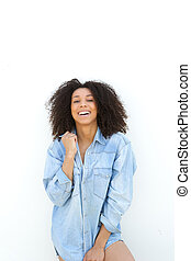African american woman laughing on white background