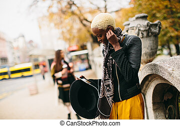 African american woman listening music outdoor