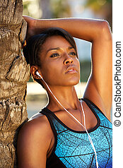 African american woman listening to music on earphones