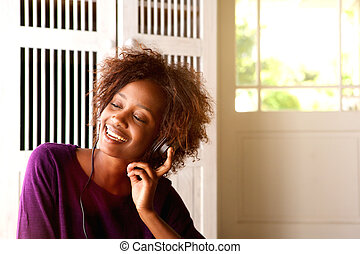 African american woman listening to music on headphones