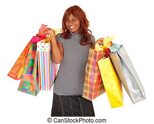 African American Woman on a Shopping Spree - A young African...