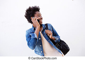 African american woman on mobile phone and looking back
