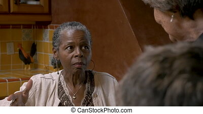 African American woman over 50 having a serious conversation...