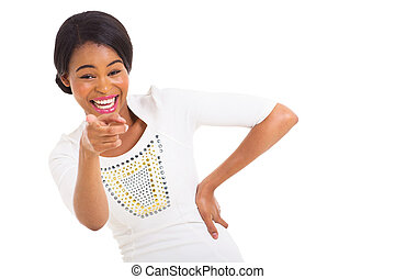 african american woman pointing and laughing