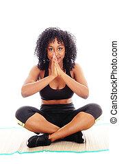 African American woman praying.